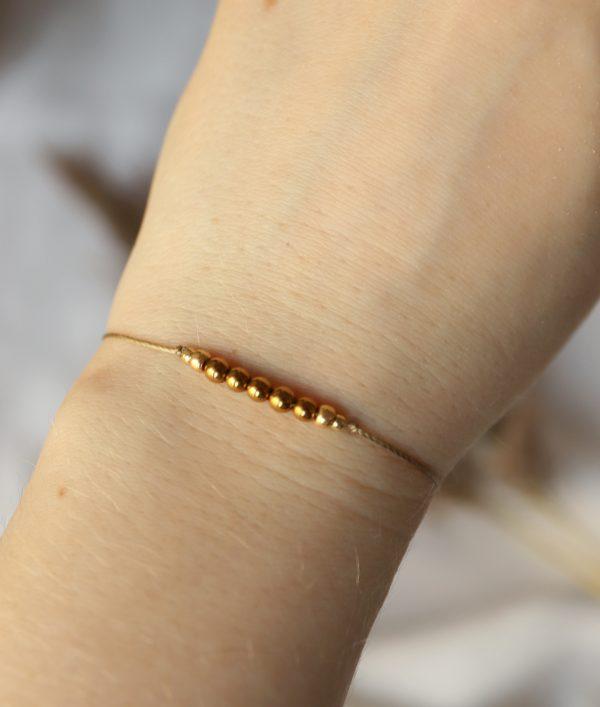 złote kuleczki hematytu na delikatnym sznureczku